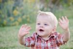 Quinn in grass waving